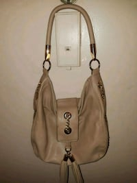 TAN LEATHER PURSE  WITH FRINGED FLAP & GOLD CHAIN New York, 10028