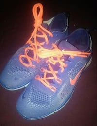 pair of blue Nike running shoes Calgary, T3C 1V3