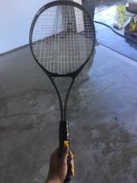 black and red tennis racket Surrey