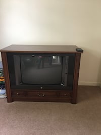 black CRT TV with brown wooden TV stand Adamstown, 21710
