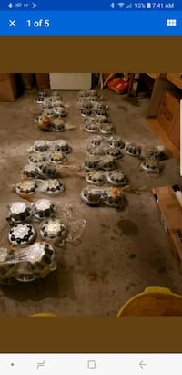 12 FULL sets of chevy 8 lug hubcaps 1037 mi