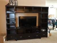 black flat screen TV with brown wooden TV hutch Falls Church, 20598