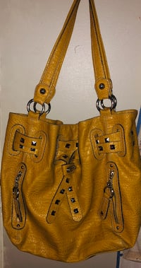 Kathy van zeeland purse. Roomy inside with plenty of pockets. Mustard colored  Rome, 30165