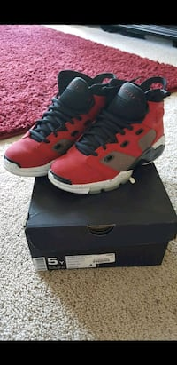 pair of red-and-black Nike basketball shoes 53 mi