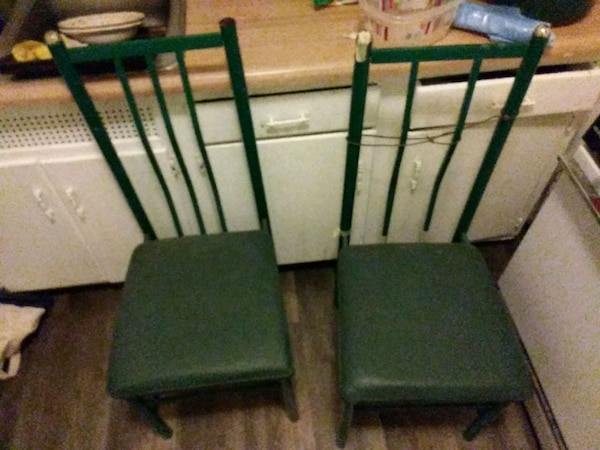 two green armless chairs