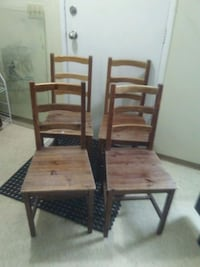 4 matching stained wood chairs very good condition Edmonton, T5T 2N9