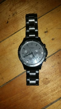 round black and silver Fossil chronograph watch with black link band Winnipeg