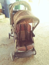 baby's brown and black stroller Lancaster, 93536