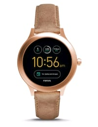 round gold-colored digital watch with brown leathe null