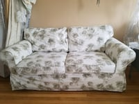 white and gray floral 2-seat sofa
