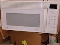 white General Electric microwave oven Columbia
