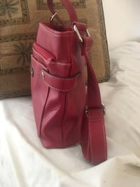 Dark red leather crossbody bag with tassel, good condition moving and all things must go  Lancaster, 93535