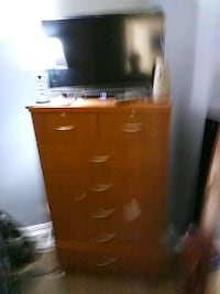 brown wooden tallboy dresser and flat screen television Dallas, 75219