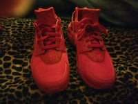 pair of red Nike running shoes Louisville, 40214