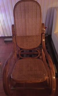Antique wooden framed brown rocking chair