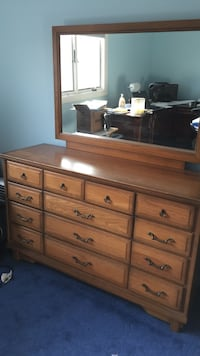 "Medium oak 56"" left to right dresser w mirror. 13 drawers. Dovetail drawers. Real wood from the 60's Rochester Hills, 48309"