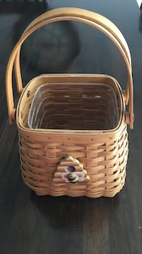 2005 longaberger tiny tote basket. Comes with protector and tie on (not longaberger ) Harpers Ferry, 25425
