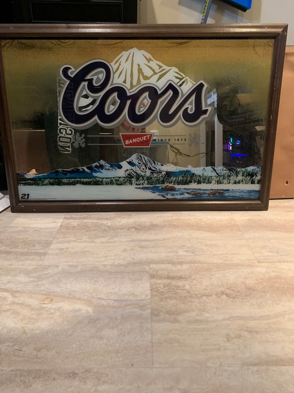 Glass Coors sign with wood frame.