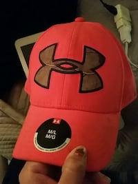 red and black Under Armour fitted cap Saskatoon, S7J 1L3