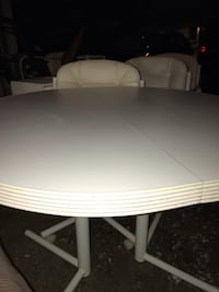White kitchen table with 5 rolling leather chairs Des Moines, 50322