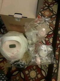 white and pink electric breast pump Centreville, 20120