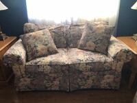 gray and white floral loveseat FREDERICK