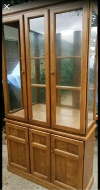 China display cabinet. Has glass doors and shelves with mirror back
