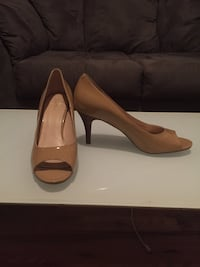 pair of brown leather open-toe pumps