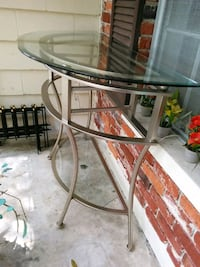 round clear glass top table with gray metal base Tampa, 33612