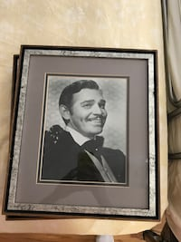 grayscale photo of man in black wooden frame New York, 11362