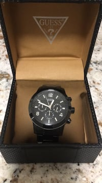 Round black chronograph watch with black link bracelet Toronto, M9V 5E7