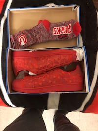 Pair of red Addias low top sneakers in box Fort George G Meade, 20755