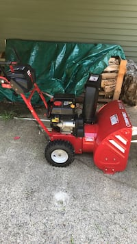 red and black Troy-bilt snow blower Brentwood, 03833