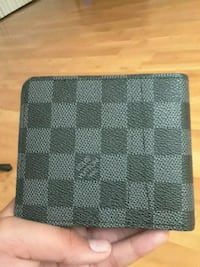 black and gray Louis Vuitton leather bi-fold walle