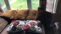 brown and white floral throw pillow 714 km