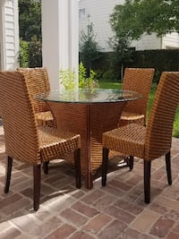 Reed table with circular glass and 4 matching chairs Houston
