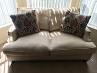 2 Cindy Crawford beige sofa with throw pillows  Altamonte Springs, 32701
