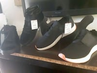 pair of black-and-white adidas sneakers 1189 mi