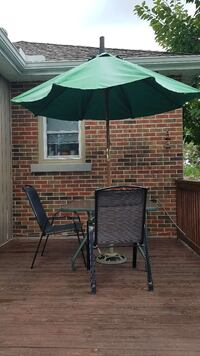 Patio table umbrella  stand and 4y chairs Cambridge, N1R 5B2