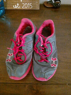 grey-and-pink Under Armour running shoes
