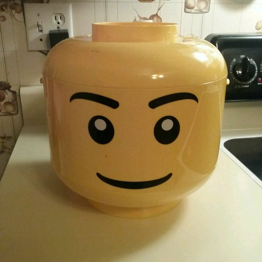 Lego head with handle to carry