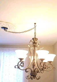 brown and white uplight chandelier 794 km