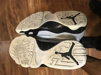 pair of white-and-black Nike basketball shoes 224 km