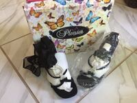 pair of women's black-and-white Pleaser brand heels with box Florissant, 63033