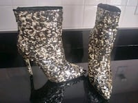 Black/gold bootie. Size 9.5. NEVER worn Bethesda, 20817