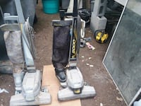two black and green upright vacuum cleaners Martinsburg, 25405