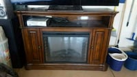 Wood Tv stand with fireplace Las Vegas, 89104