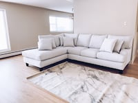 white  sectional sofa with 6 throw pillows Calgary, T2A