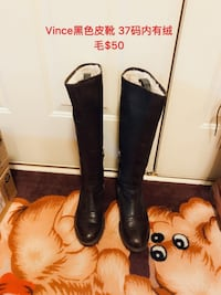 pair of black leather boots 582 mi