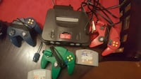 black Nintendo 64 console with controller and game